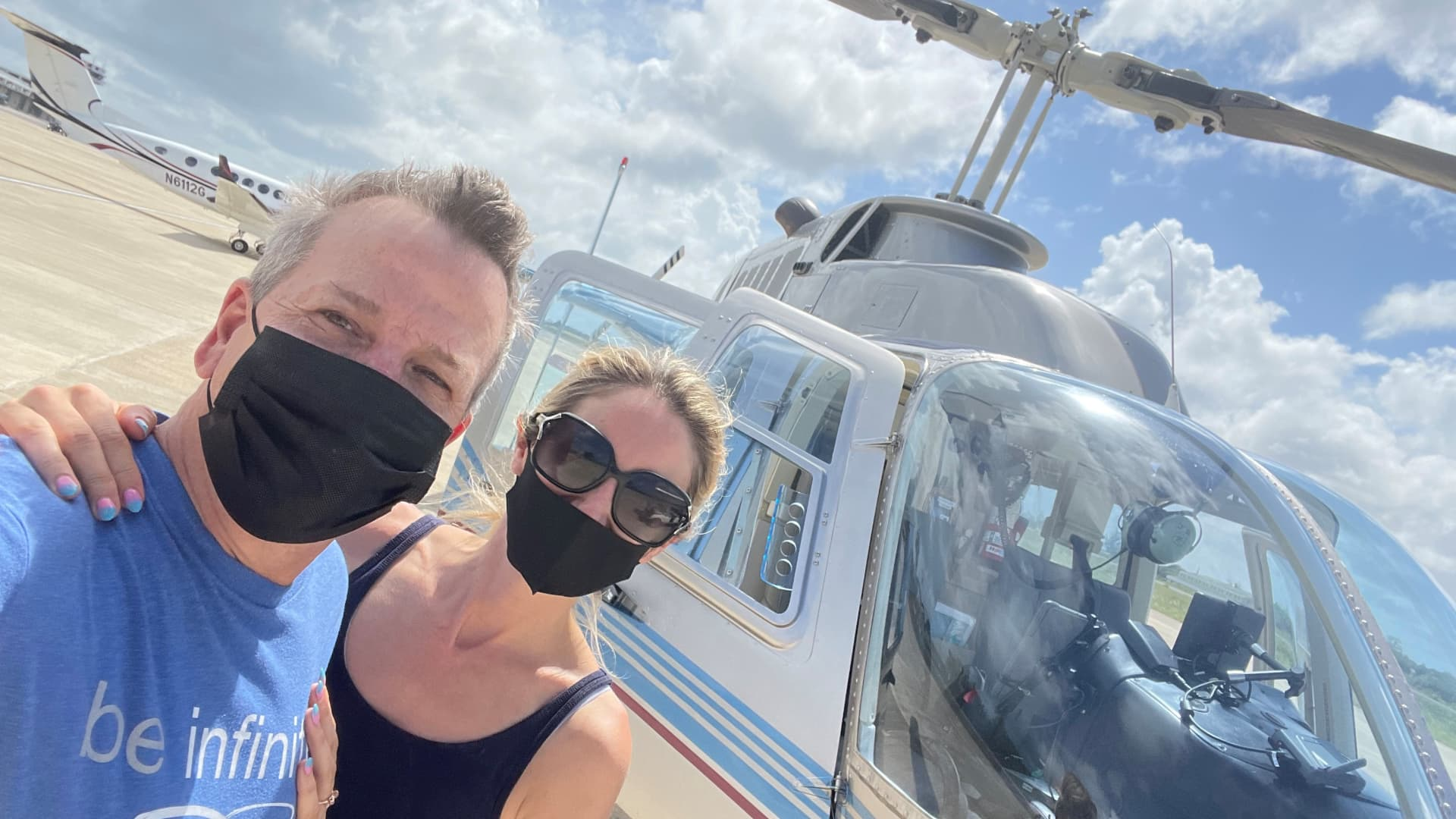 Ken McElroy and Danille Underwood boarding a helicopter to fly to Belize City.