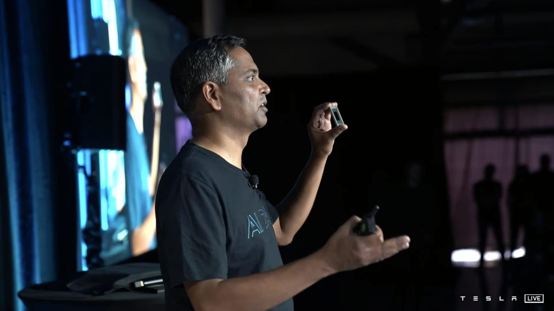 Ganesh Venkataramanan, senior director of Autopilot hardware at Tesla, shows a D1 training chip during Tesla's live-streamed AI Day on Aug. 19, 2021.