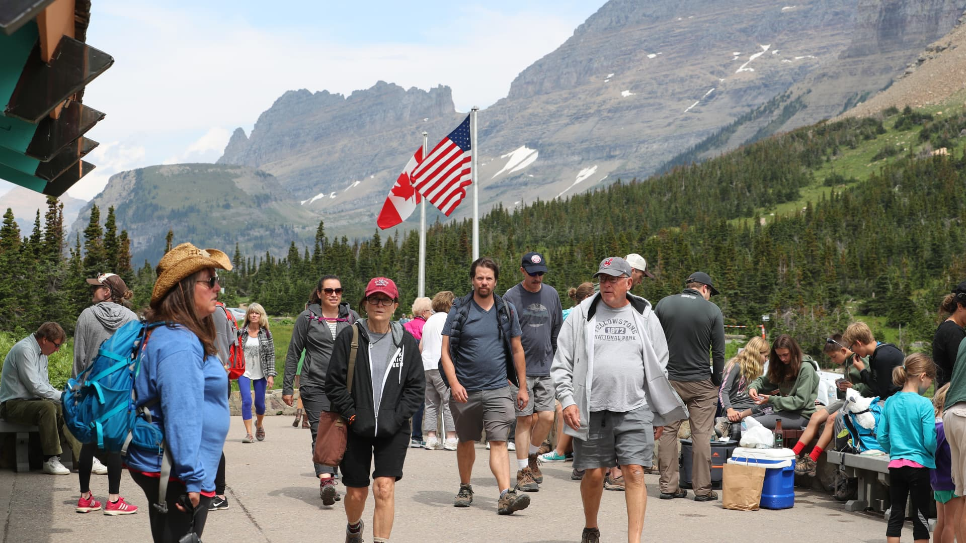 Visitors walk around the Logan Pass Visitor Center in Glacier National Park on July 26, 2018 in West Glacier, Montana.