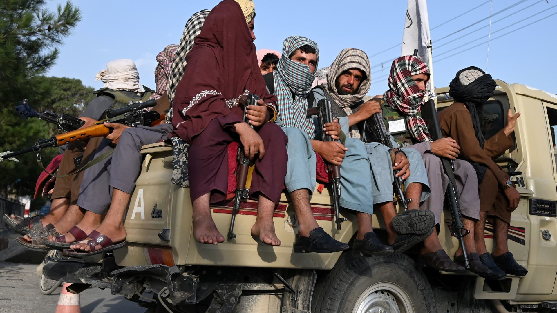 Taliban fighters in a vehicle patrol the streets of Kabul on August 23, 2021 as in the capital, the Taliban have enforced some sense of calm in a city long marred by violent crime, with their armed forces patrolling the streets and manning checkpoints.
