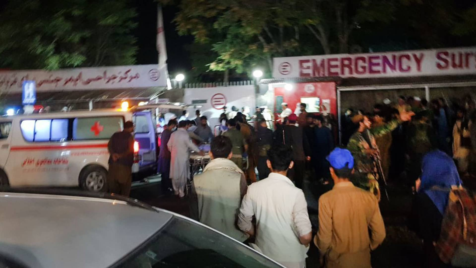 Injured people being carried to a hospital as unspecified number of casualties reported after two explosions outside Hamid Karzai International Airport in Kabul, Afghanistan on August 26, 2021.