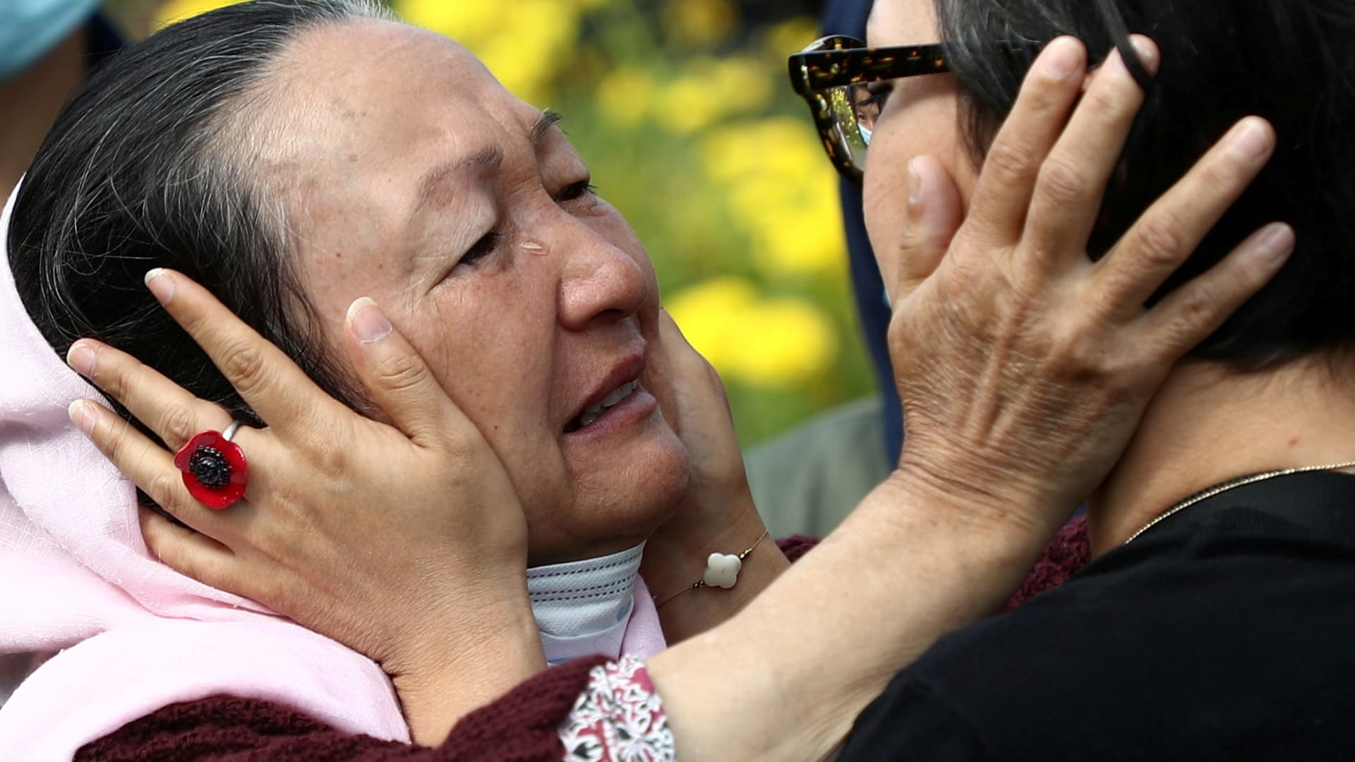 Shakiba Dawod, an Afghan artist who lives in France, kisses her mother, Qadira, at a reception center near Paris on Aug. 27, 2021. They are reuniting for the first time in 12 years, after Dawod's family was evacuated from Afghanistan.