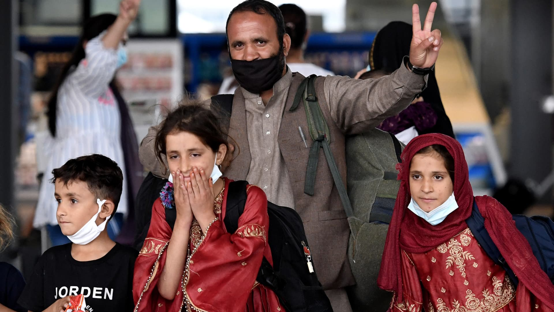 An Afghan family arrives at Dulles International Airport in Virginia on Aug. 27, 2021, after being evacuated from Kabul following the Taliban takeover of Afghanistan.