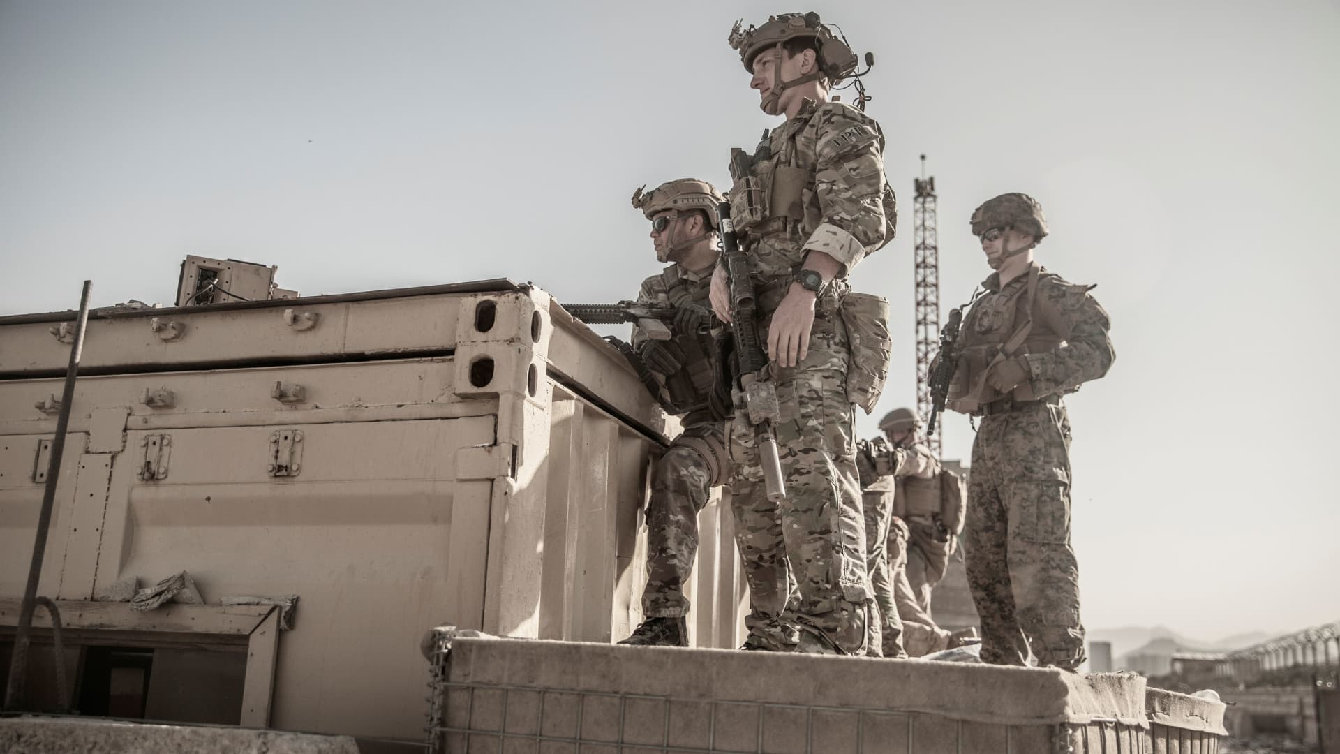 U.S. service members assist at an Evacuation Control Check Point (ECC) during an evacuation at Hamid Karzai International Airport, Kabul, Afghanistan, August 26, 2021.