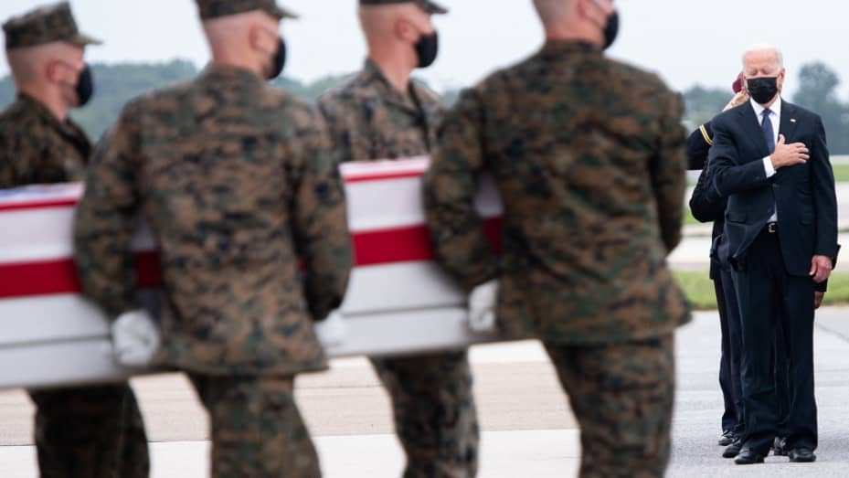 US President Joe Biden attends the dignified transfer of the remains of a fallen service member at Dover Air Force Base in Dover, Delaware, August, 29, 2021.