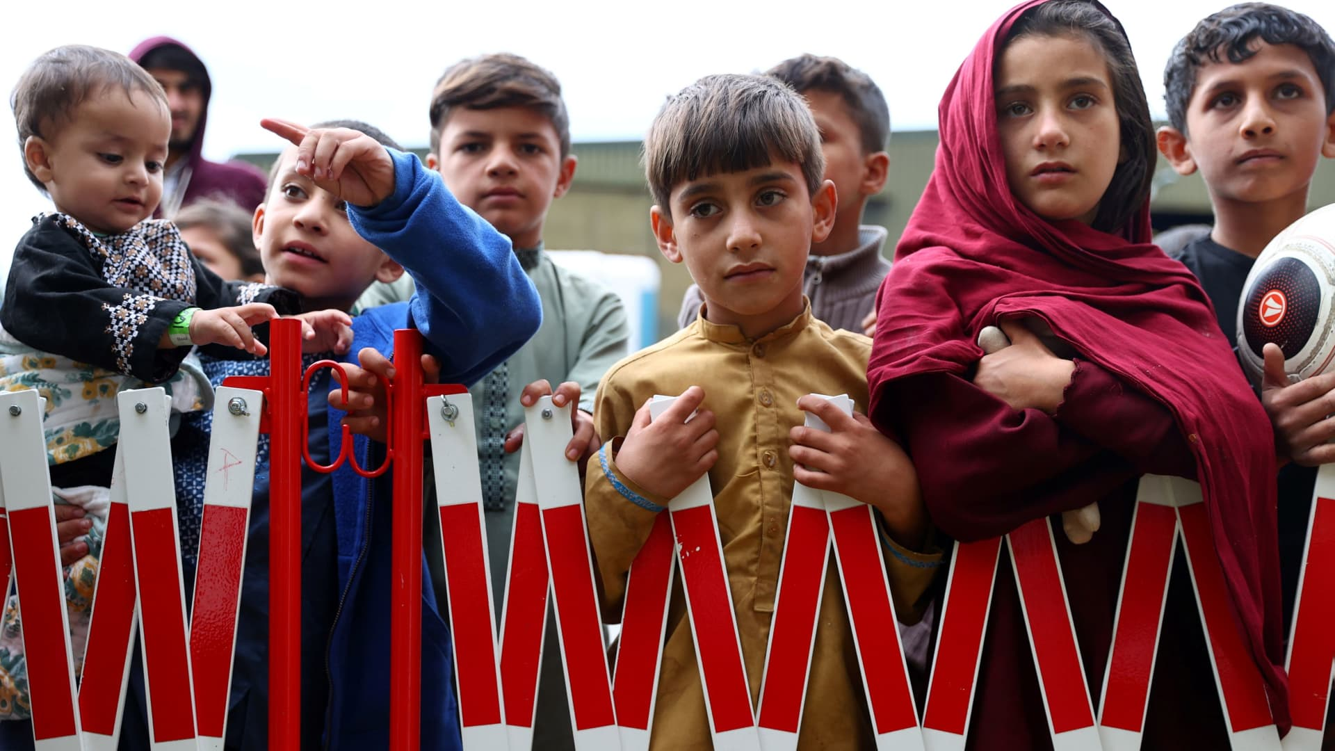 Children evacuated from Afghanistan wait at a temporary shelter in the U.S. Army's Rhine Ordnance Barracks in Kaiserslautern, Germany, on Aug. 30, 2021.