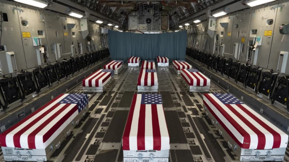 In this image provided by the U.S. Air Force, flag-draped transfer cases line the inside of a transport plane Sunday before a dignified transfer at Dover Air Force Base, Del. The fallen service members were killed while supporting evacuations in Kabul, Afghanistan.