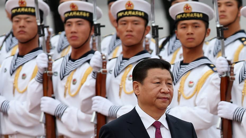 Chinese President Xi Jinping with a naval honor guard.