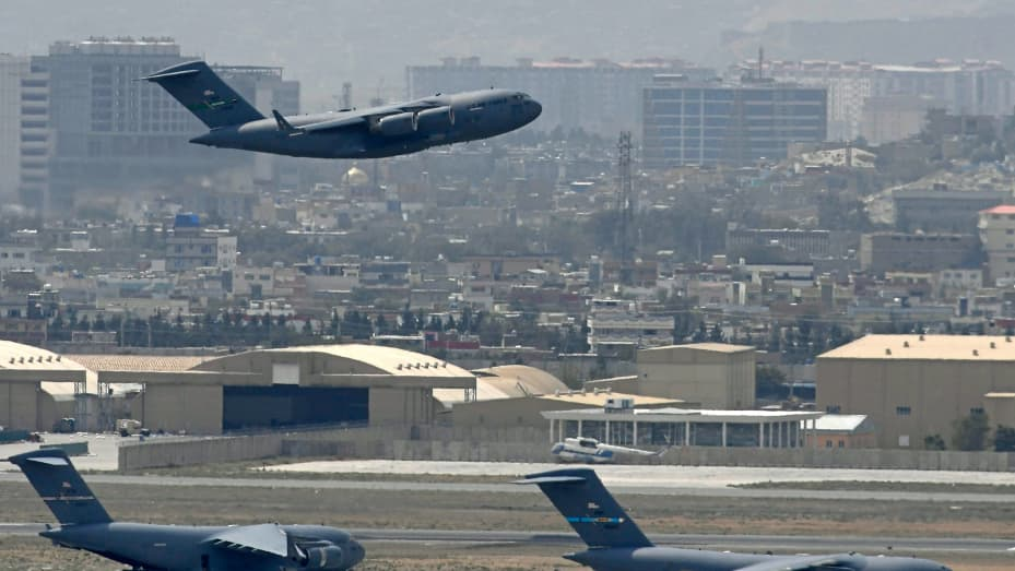 A US Air Force aircraft takes off from the airport in Kabul on August 30, 2021.