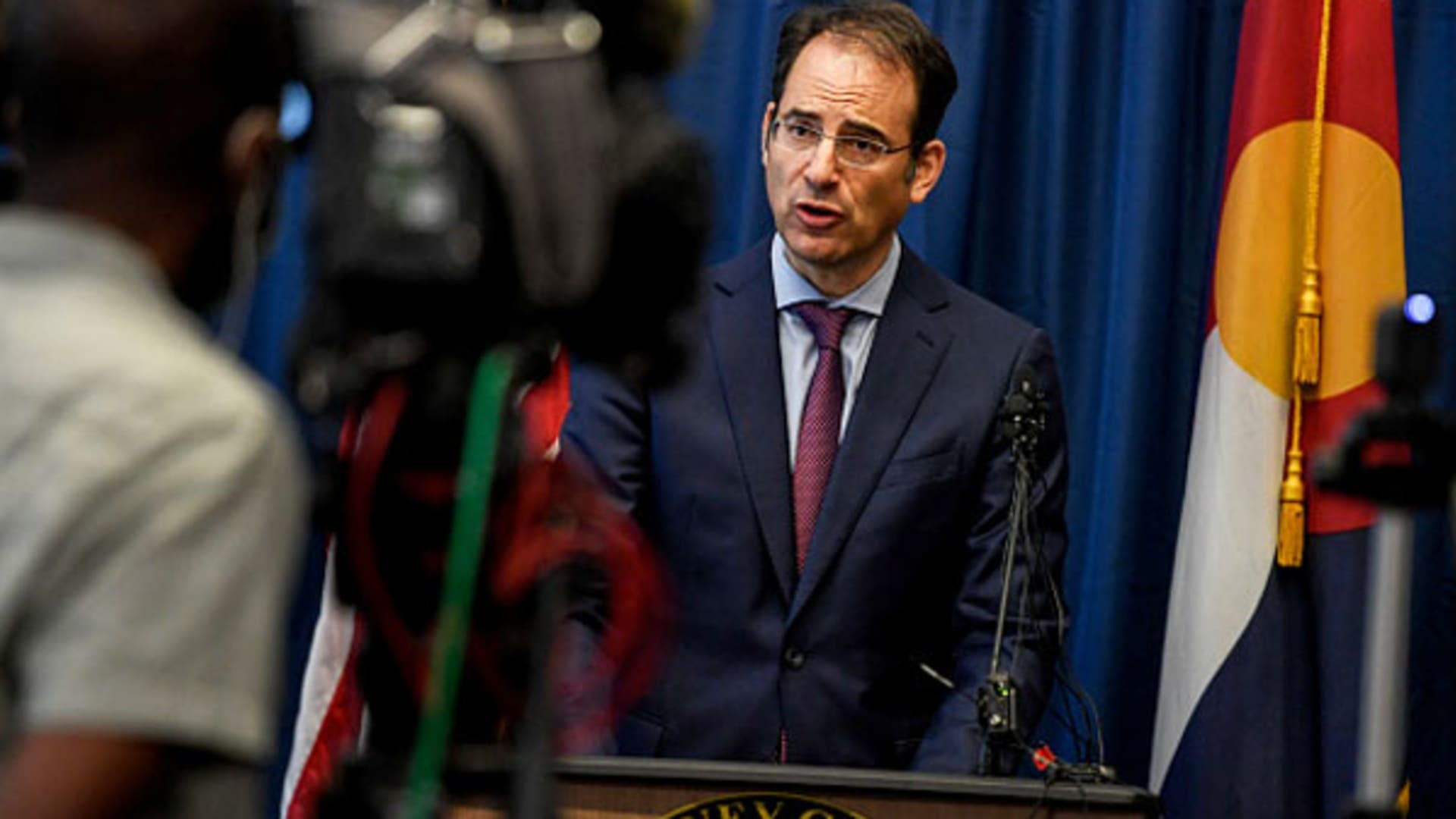 Colorado attorney general Phil Weiser speaks during a press conference announcing an indictment of the three Aurora police officers and two Aurora fire paramedics in the death of Elijah McClain on Wednesday, September 1, 2021.