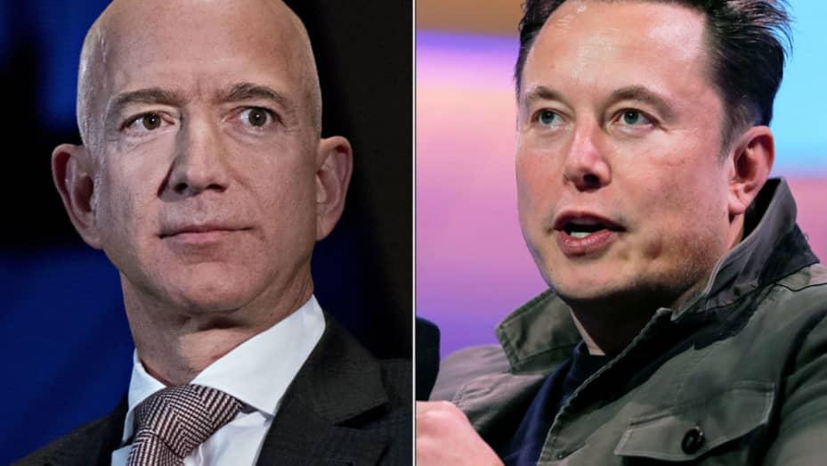 Jeff Bezos, links, und Elon Musk