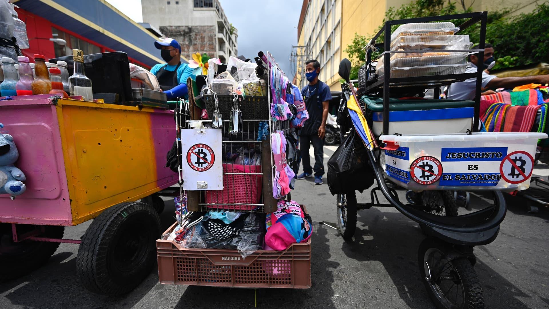 Street vendors in San Salvador with anti-bitcoin stickers.