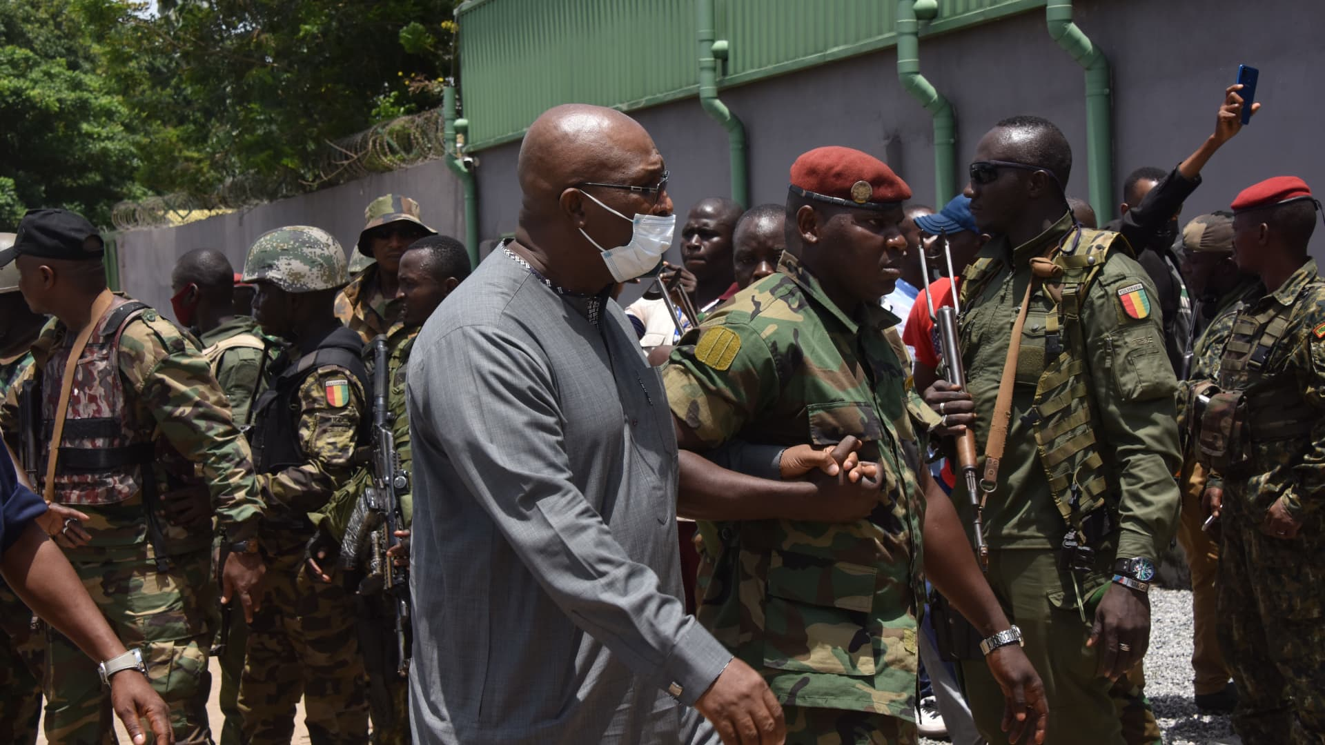 CONAKRY, Guinea - A government official escorted by members of Guinea's special forces walks into the Palace of the People in Conakry, Guinea, Sept. 6, 2021.
