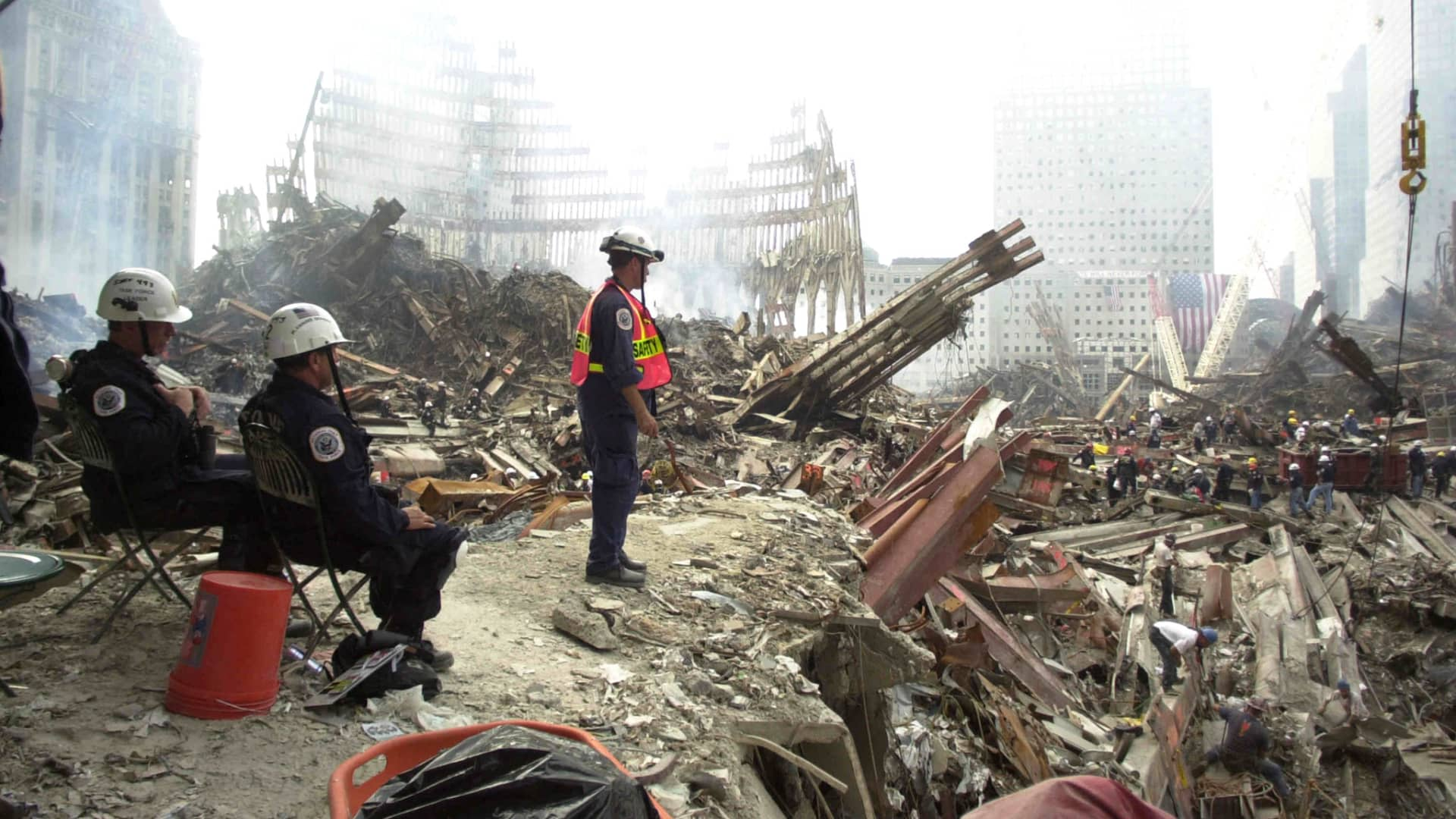 Rescue workers sift through debris at the ground Zero of what remains of the World Trade Center twin towers site, September 24, 2001.