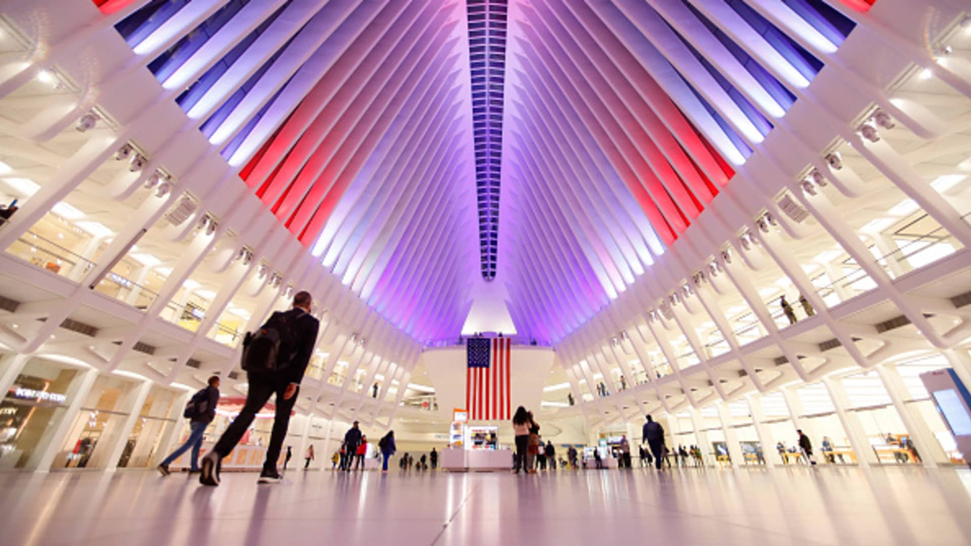 The Oculus transit hub at One World Trade Center turns on its new LED lights in red, white and blue in honor of Veterans Day on November 10, 2020 in New York City.