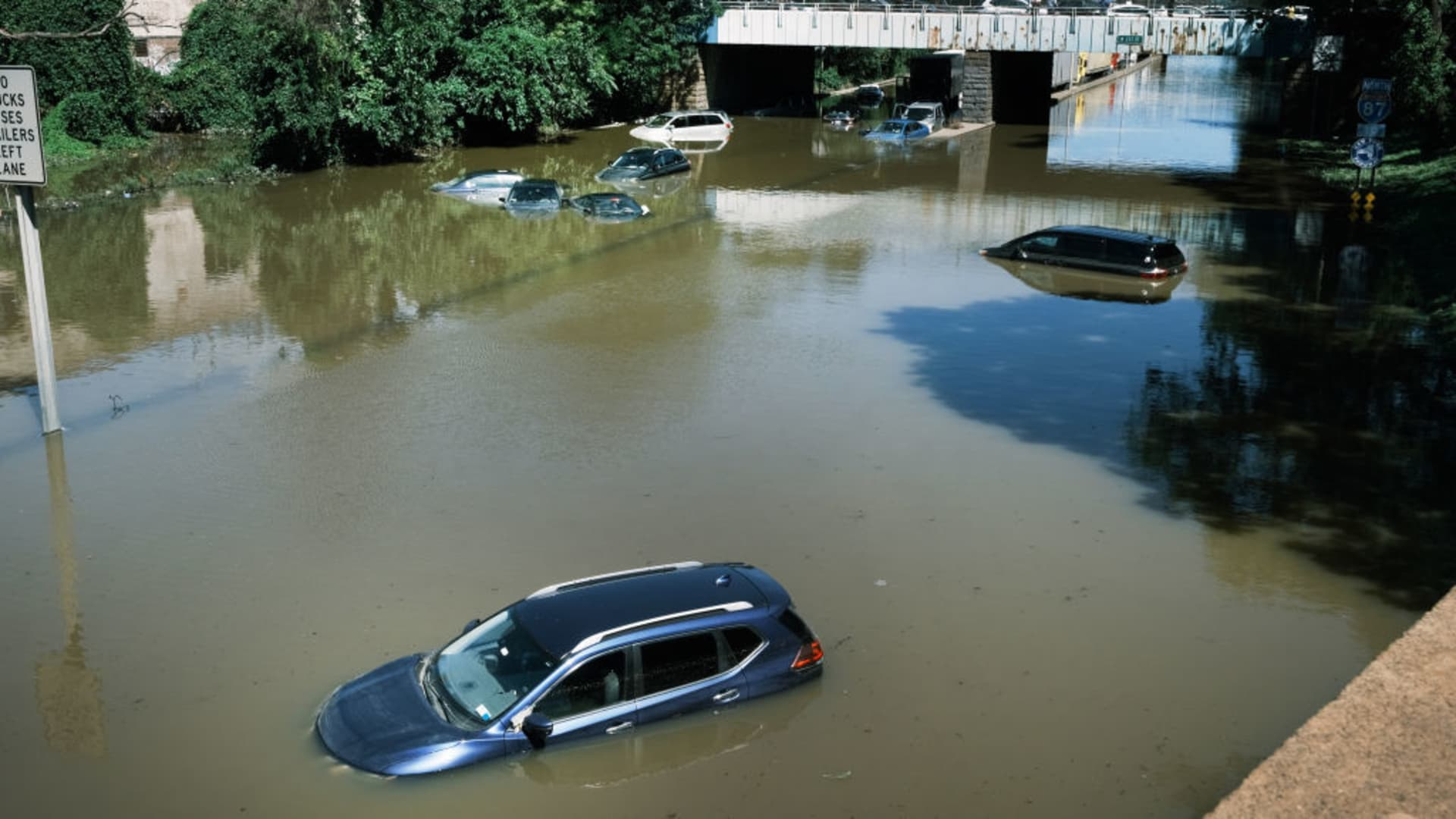Cars sit abandoned on the flooded Major Deegan Expressway following a night of extremely heavy rain from the remnants of Hurricane Ida on September 2, 2021 in the Bronx borough of New York City.