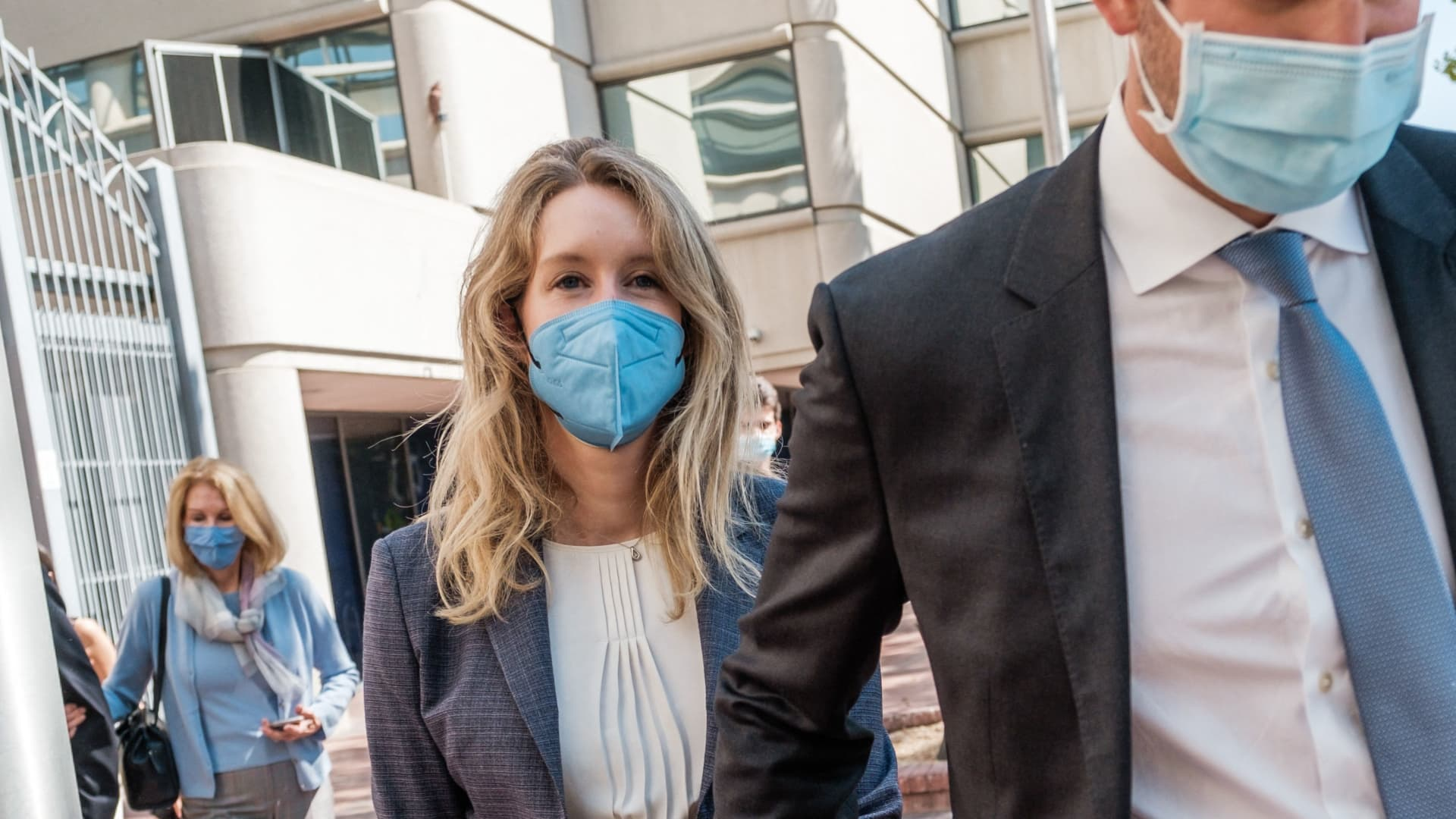 Elizabeth Holmes (L), founder and former CEO of Theranos, leaves the courthouse with her husband Billy Evans after the first day of her fraud trial in San Jose on Sept. 8, 2021.