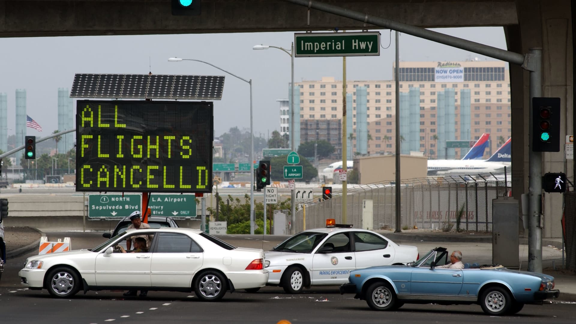 Cars sit outside Los Angeles International Airport (LAX), which is closed because of the air attacks on New York and Washington, DC, September 11, 2001, in Los Angeles, CA.