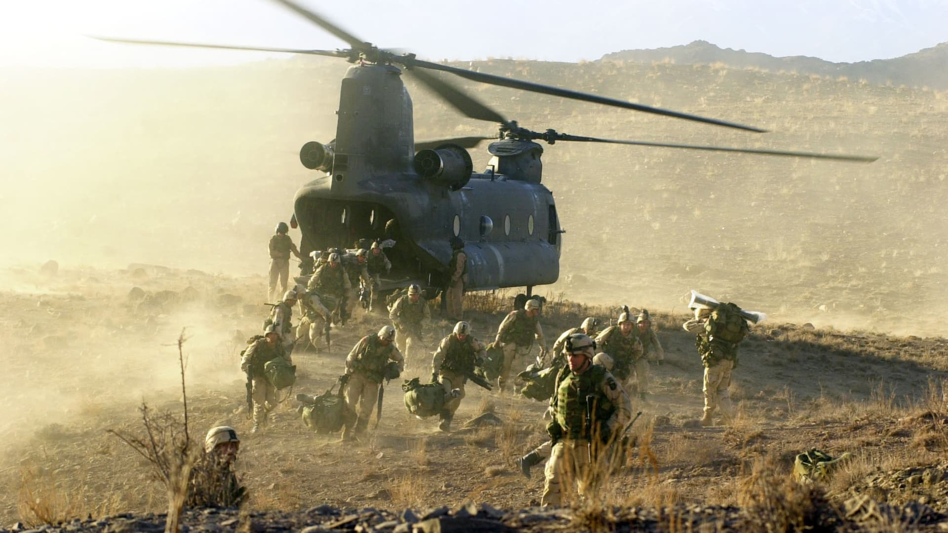 U.S. Army soldiers from the 101st Airborne division off load during a combat mission from a Chinook 47 helicopter March 5, 2002 in Eastern Afghanistan.