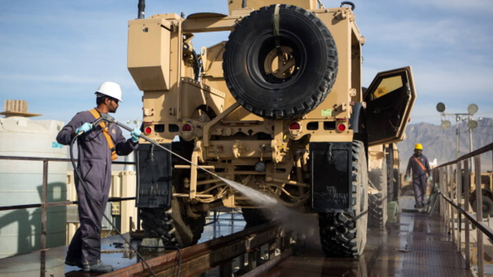 A civilian contractor power washes a Mine-Resistant All-Terrain Vehicle May 9, 2013 at Bagram Air Base, Afghanistan.