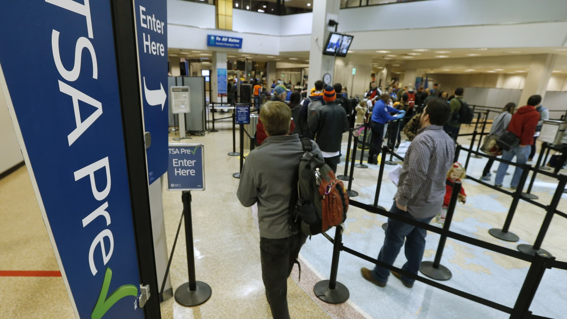 A passenger enters the Transportation Security Administration (TSA) pre-check line towards a security check point at Salt Lake City International Airport in Salt Lake City, Utah, U.S., on Tuesday, Dec. 23, 2014.
