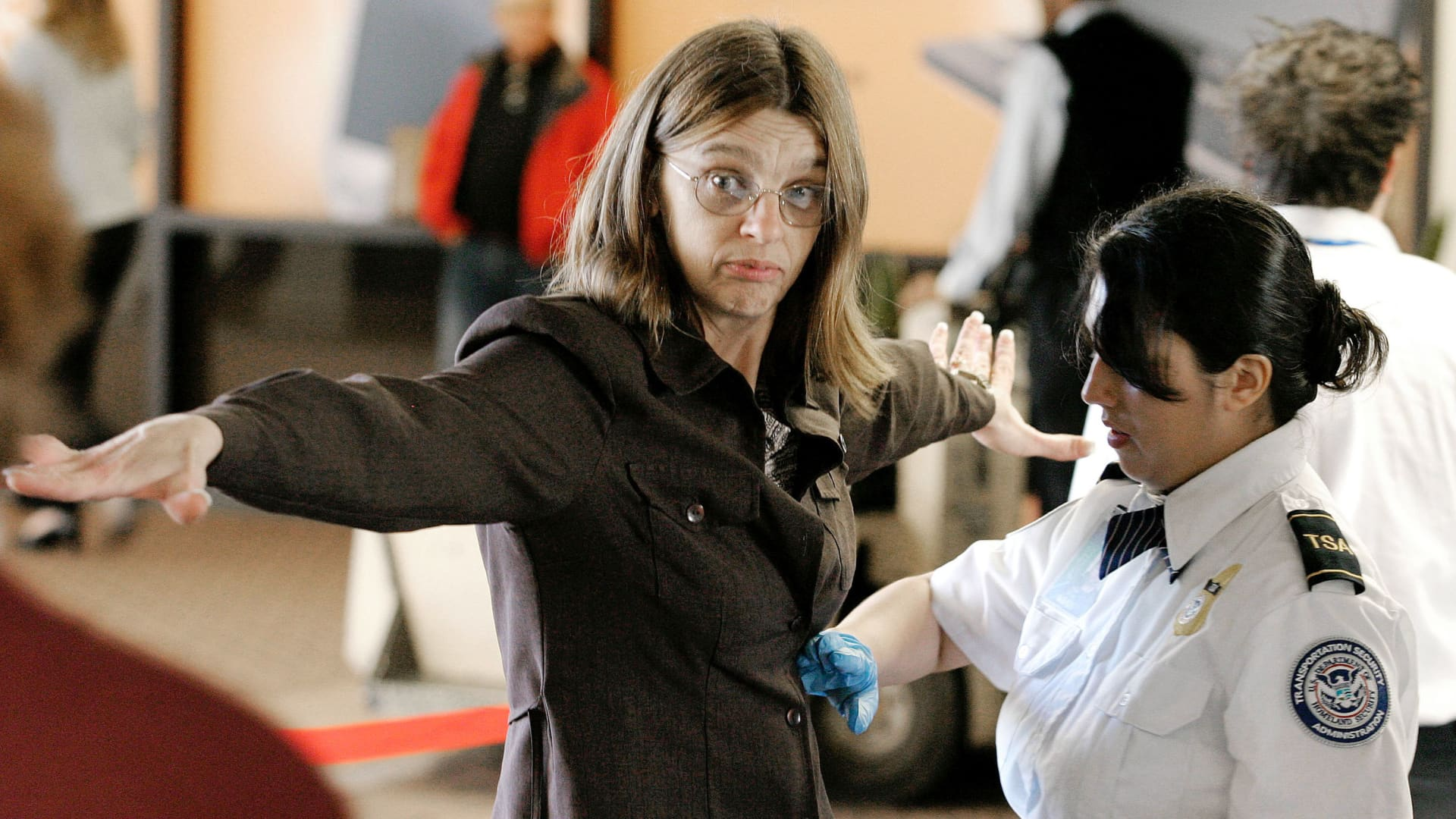 A Transportation Security Administration agent performs a pat-down check on an airline passenger at a security checkpoint in terminal four at Phoenix Sky Harbor International Airport December 10, 2004 in Phoenix, Arizona.