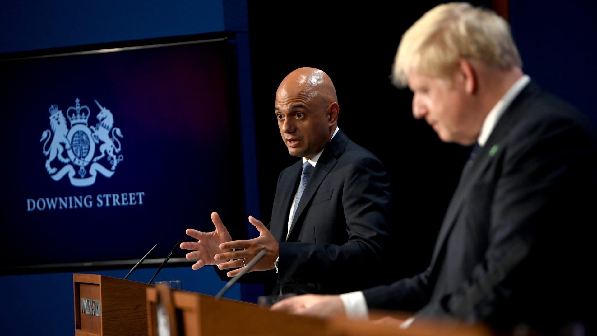 Sajid Javid, U.K. health secretary, left, and Boris Johnson, U.K. prime minister, during a news conference inside number 10 Downing Street in London, U.K., on Tuesday, Sept. 7, 2021.