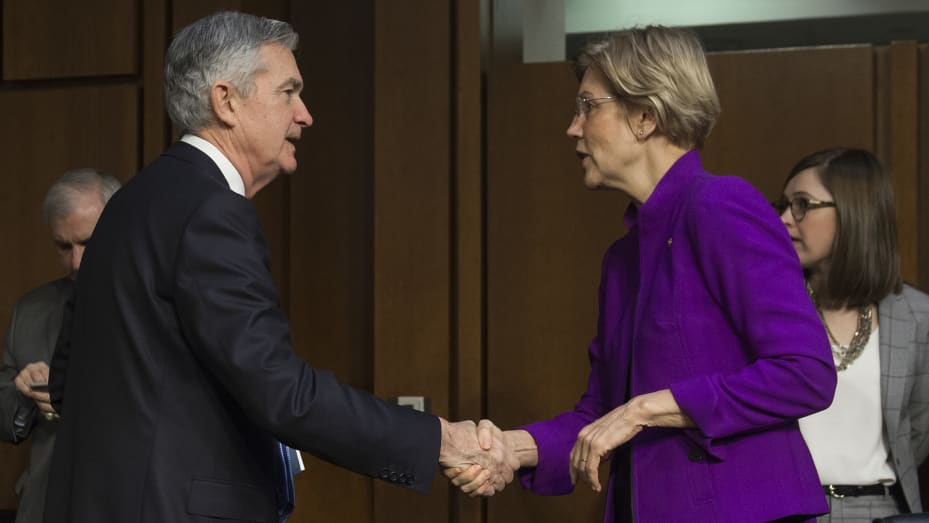 Jerome Powell, nominee to be chairman of the Federal Reserve Board of Governors, shakes hands with US Senator Elizabeth Warren (R), Democrat of Massachusetts, prior to testifying during his confirmation hearing before the Senate Banking, Housing and Urban