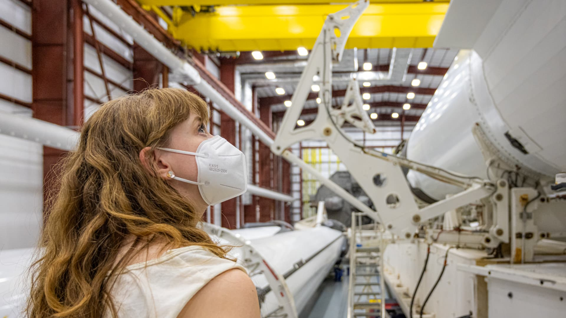 Hayley Arceneaux takes a look at the SpaceX Crew Dragon capsule and Falcon 9 rocket that will carry the crew to orbit.