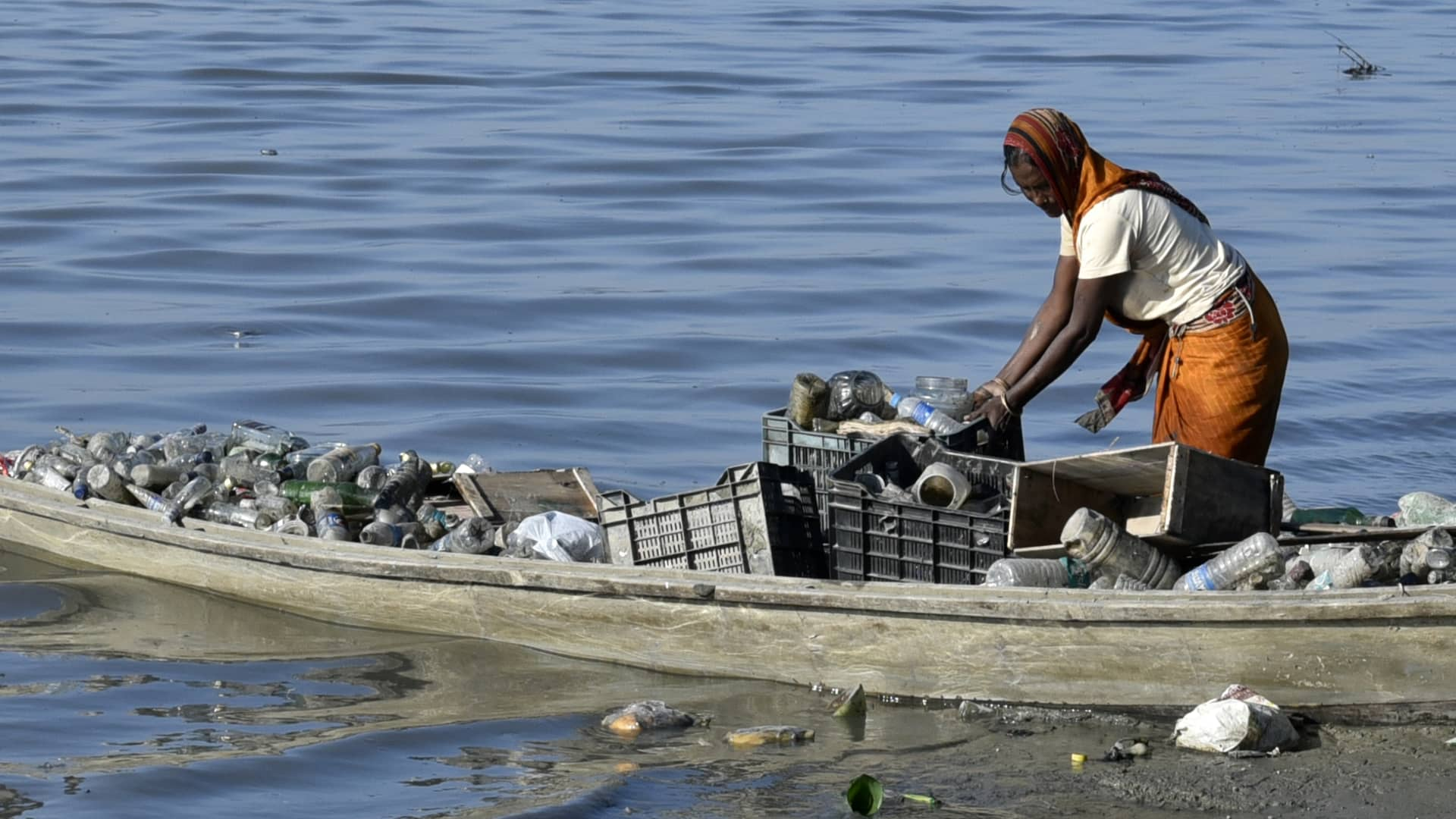 A women rag picker collecting plastic bottle and other plastic materials in a boat from the bank of Brahmaputra River in Guwahati, Assam, India on Monday, October 29, 2018.