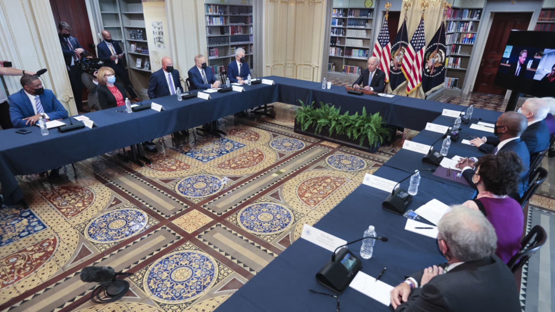 U.S. President Joe Biden, center, speaks during a meeting in the Eisenhower Executive Office Building Library in Washington, D.C., U.S., on Wednesday, Sept. 15, 2021.