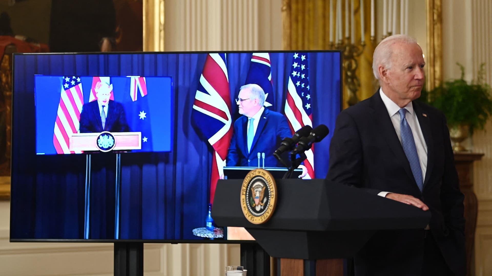 US President Joe Biden participates is a virtual press conference on national security with British Prime Minister Boris Johnson and Australian Prime Minister Scott Morrison in the East Room of the White House in Washington, DC, on September 15, 2021.