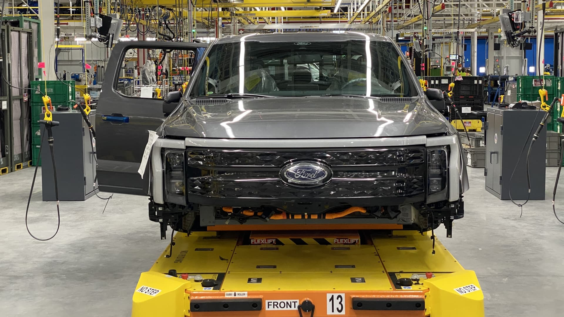 Ford has started initial pre-production of its electric F-150 Lightning pickup truck at a new plant in Dearborn, Mich.