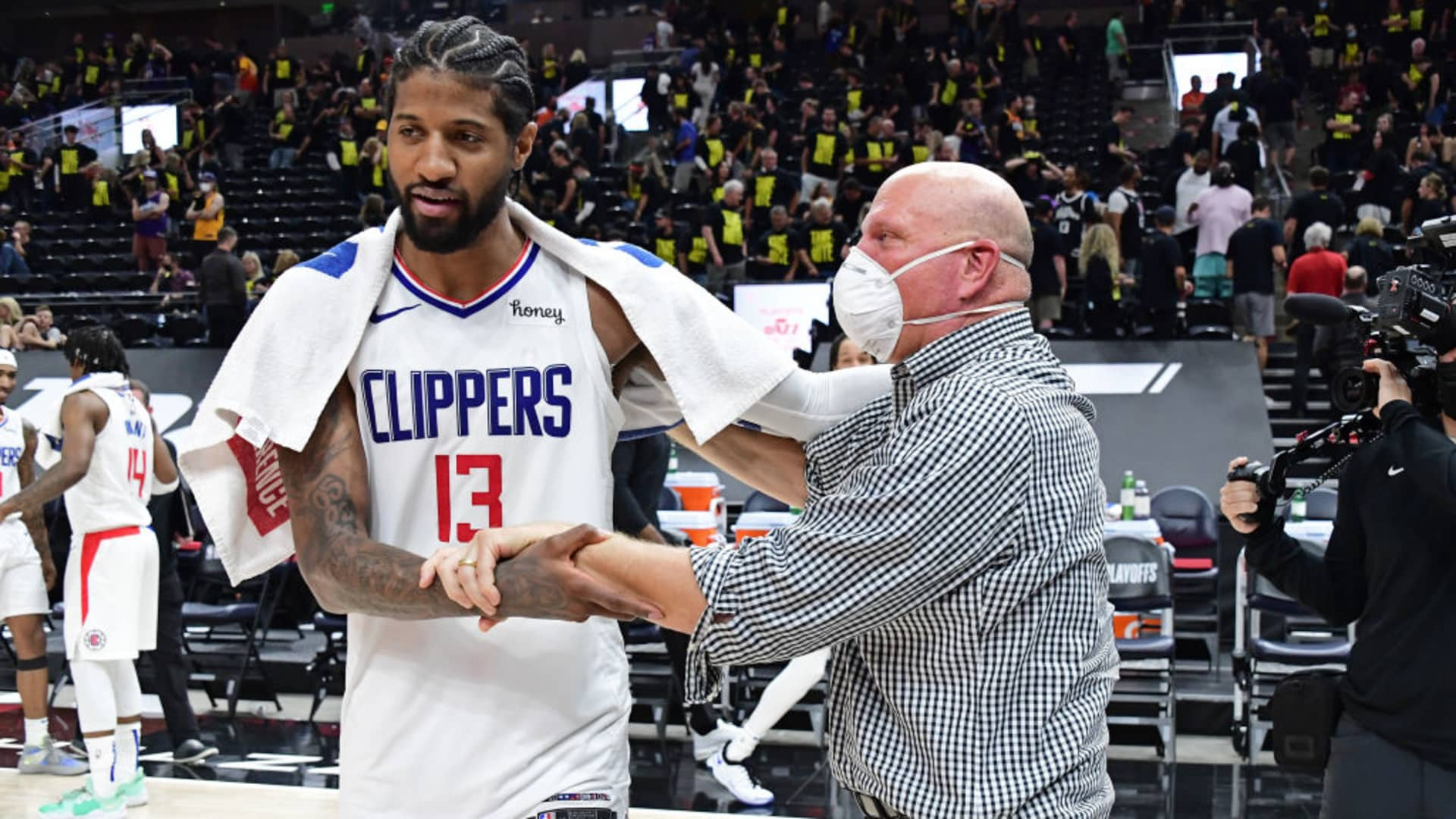 Paul George #13 of the LA Clippers talks to Owner, Steve Ballmer of the LA Clippers after the game against the Utah Jazz during Round 2, Game 5 of the 2021 NBA Playoffs on June 16, 2021 at vivint.SmartHome Arena in Salt Lake City, Utah.