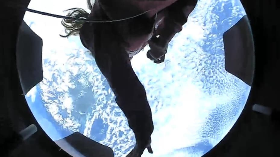 Hayley Arceneaux takes in the view of Earth from the Crew Dragon cupola window.