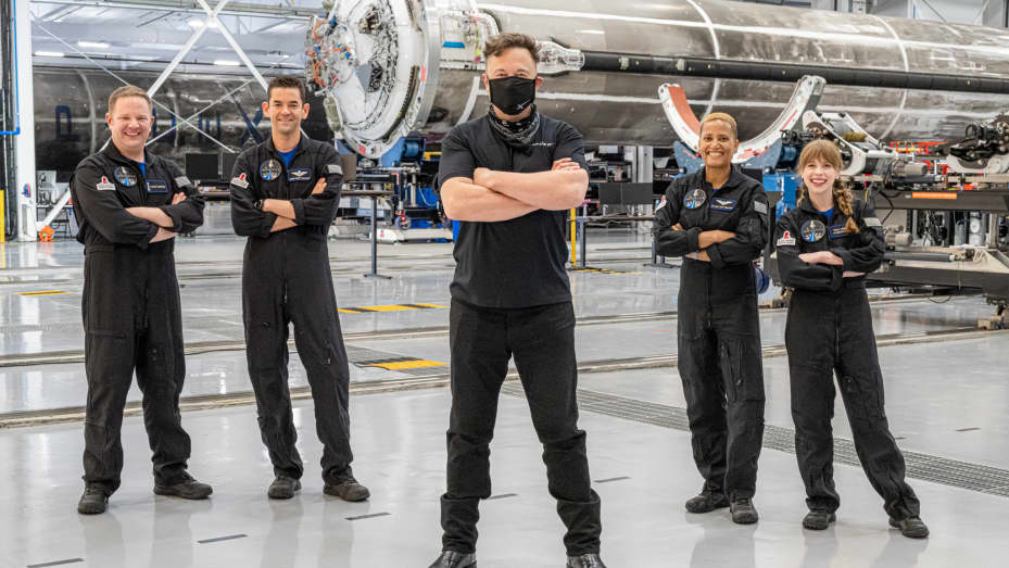 SpaceX CEO Elon Musk poses with the crew before launch on September 15, 2021.