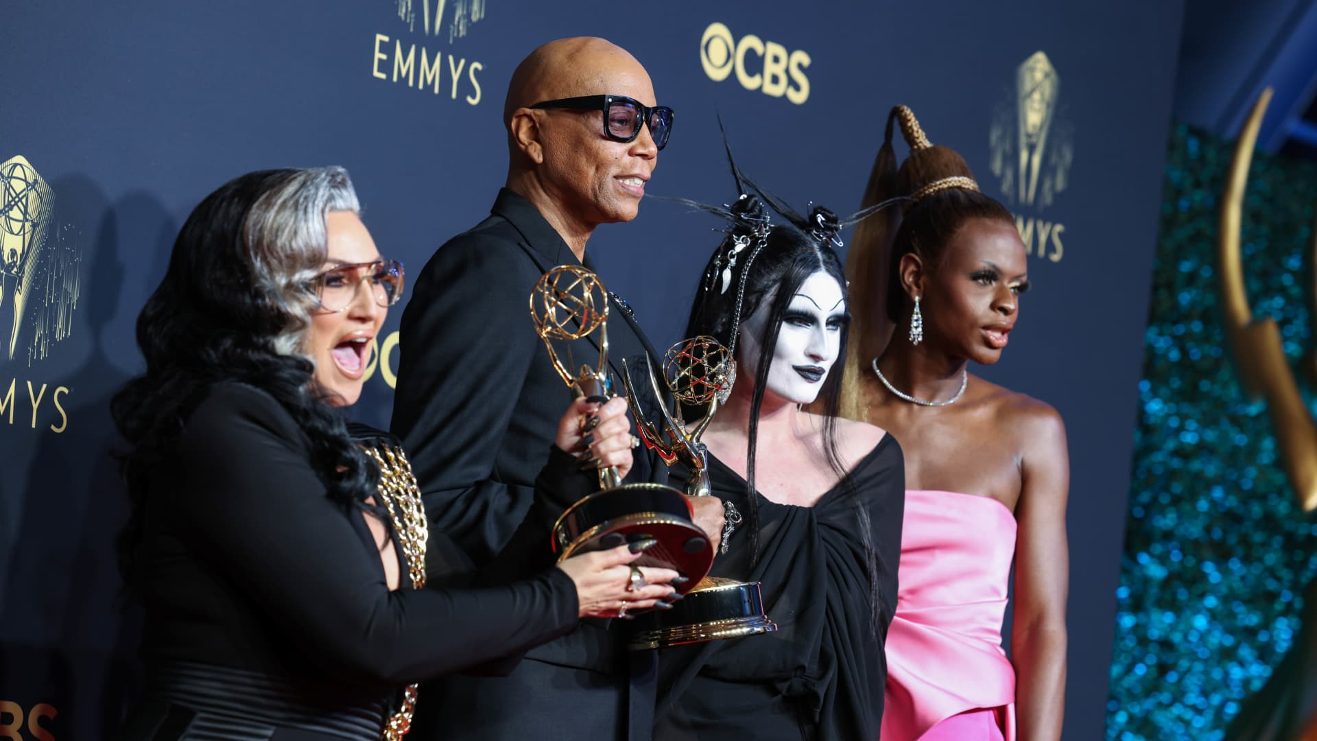 (L-R) Michelle Visage, RuPaul, Gottmik, and Symone, winners of the Outstanding Competition Program award for 'RuPaul's Drag Race,' pose in the press room during the 73rd Primetime Emmy Awards at L.A. LIVE on September 19, 2021 in Los Angeles, California.