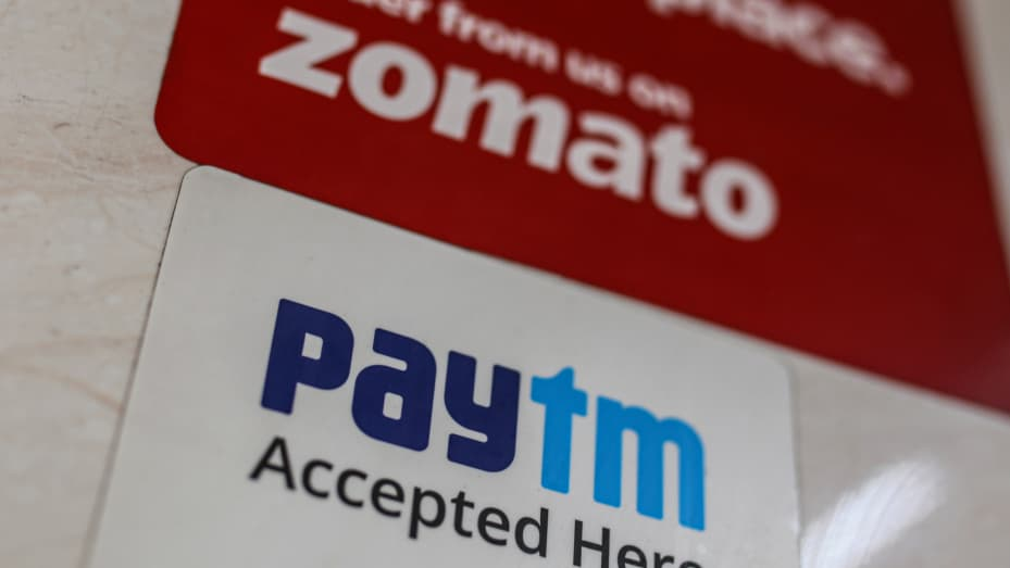 A store advertises the use of the Paytm digital payment system and the Zomato food delivery app in Mumbai, India, on Saturday, July 17, 2021.
