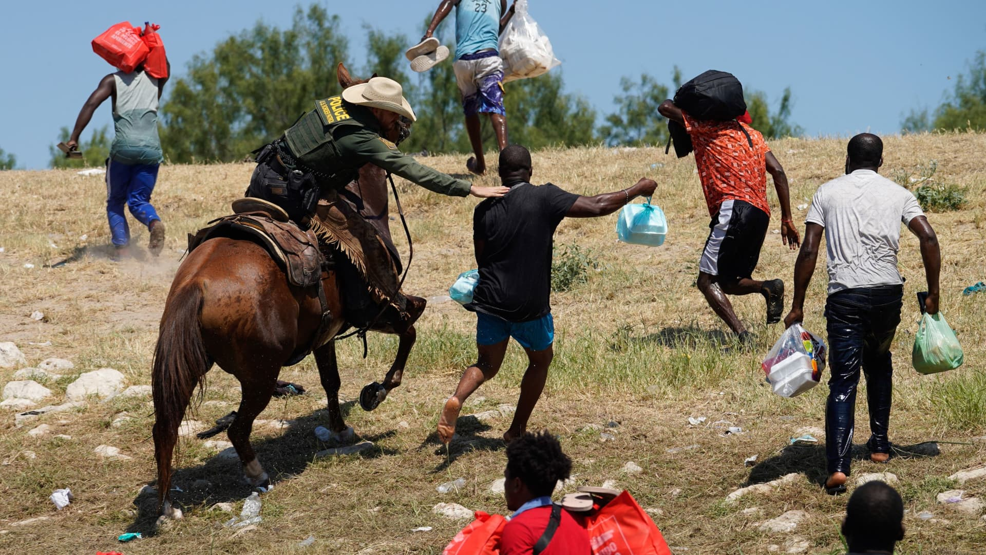 A United States Border Patrol agent on horseback tries to stop a Haitian migrant from entering an encampment on the banks of the Rio Grande near the Acuna Del Rio International Bridge in Del Rio, Texas on September 19, 2021.