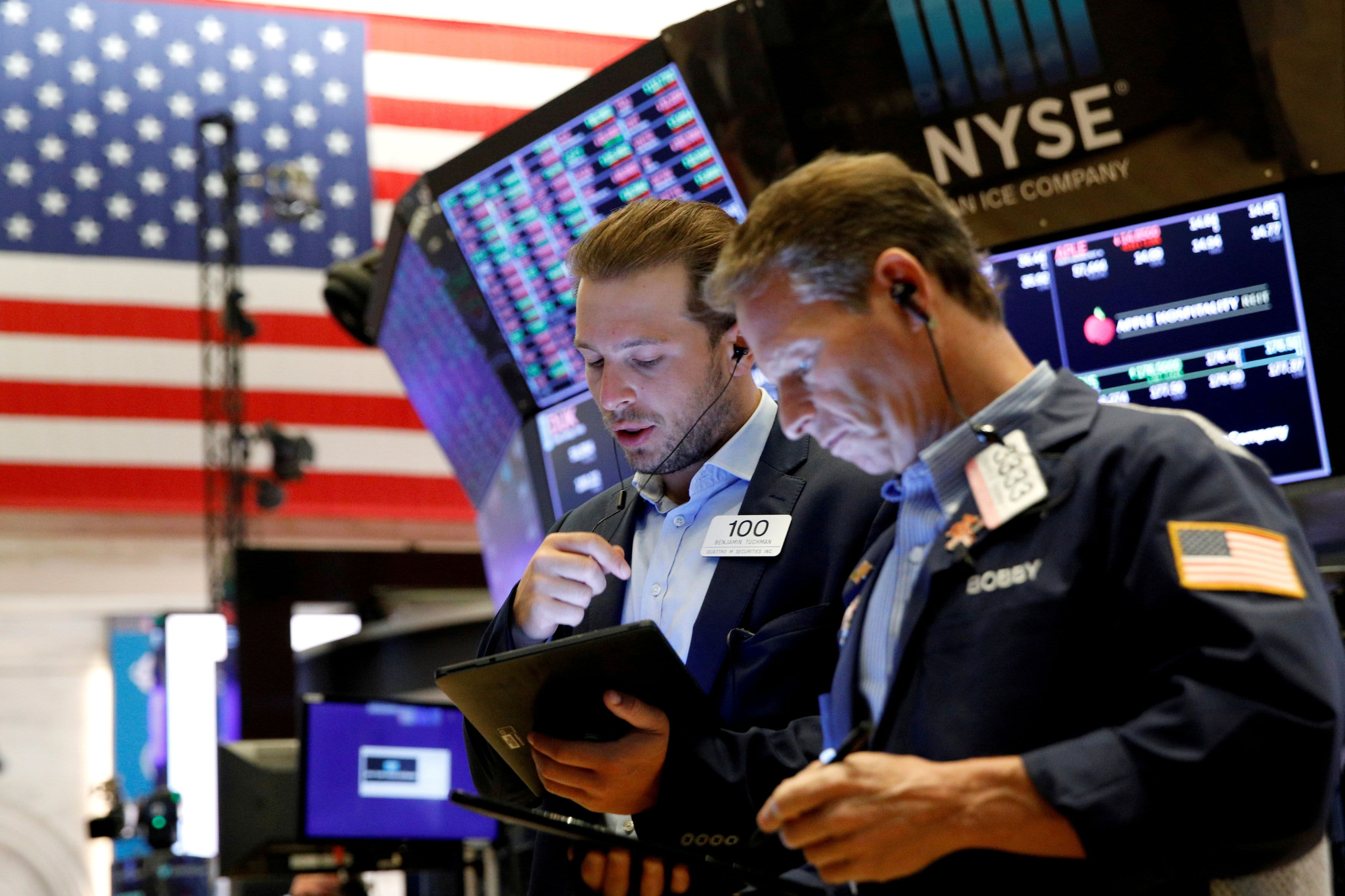 Stock futures rise slightly ahead of bank earnings and a key inflation report