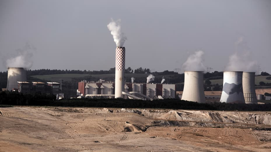 Vapor rises from the cooling towers of the Turow coal powered power plant, operated by PGE SA, in Bogatynia, Poland.