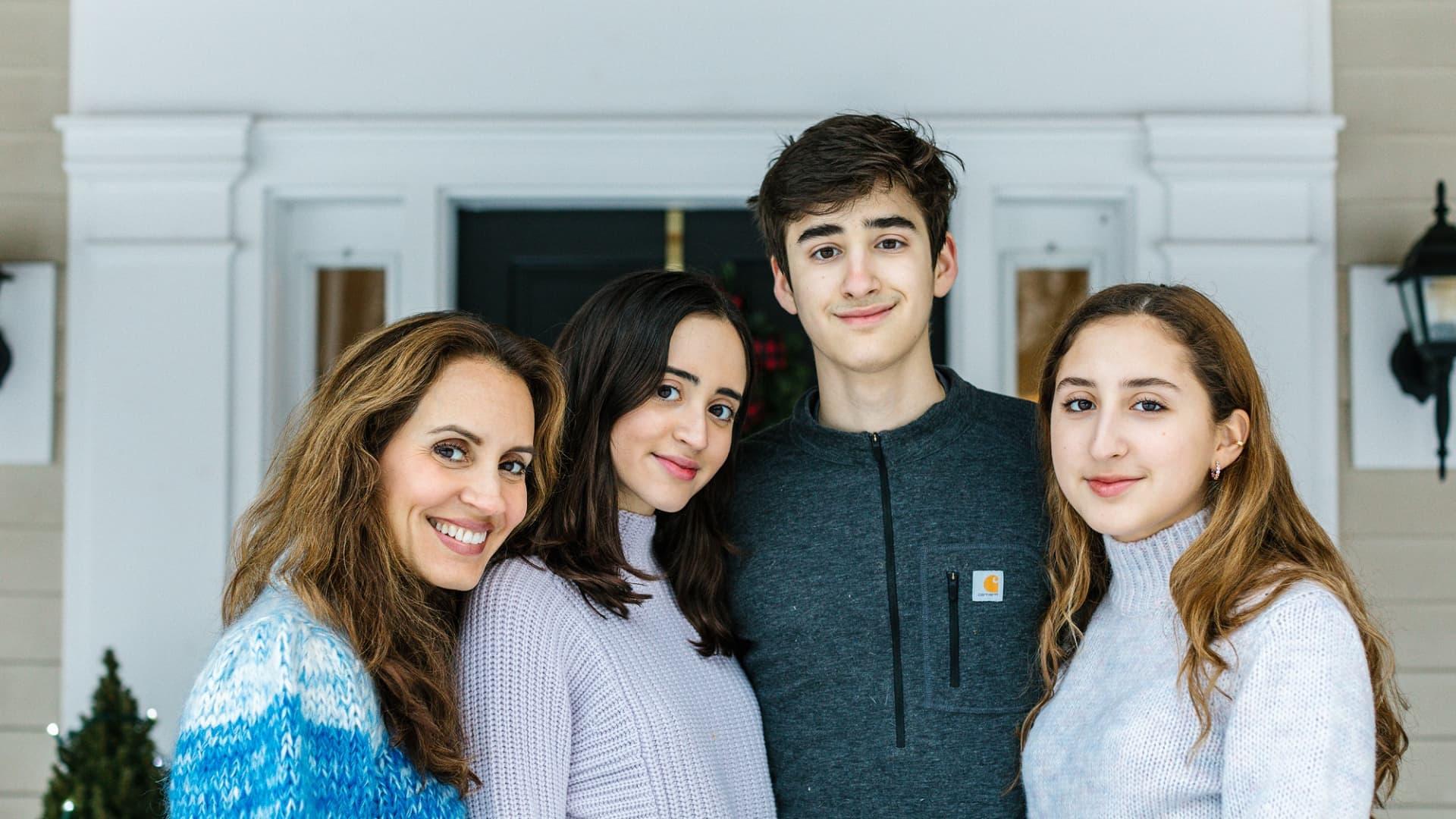 Sandra Campos with her three children