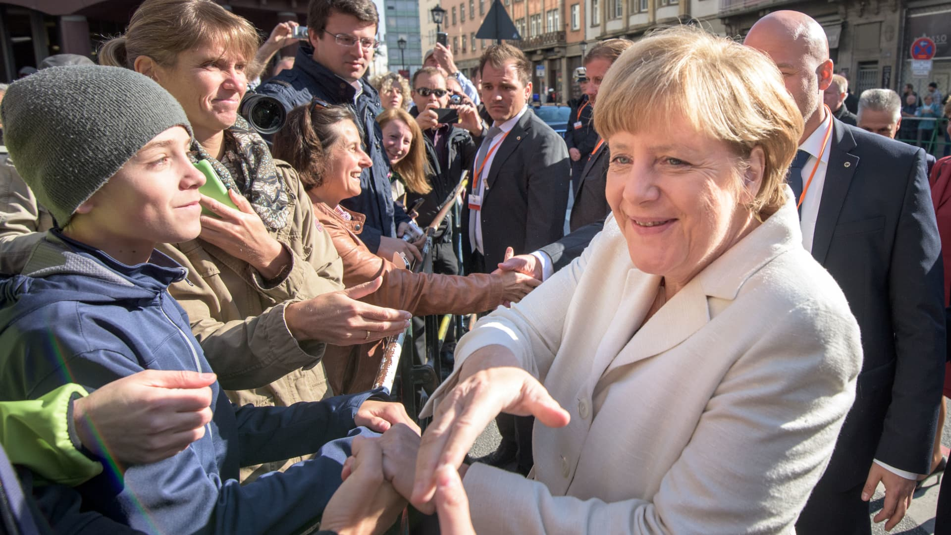 Outgoing German Chancellor Angela Merkel greets the crowds in Frankfurt, Germany.