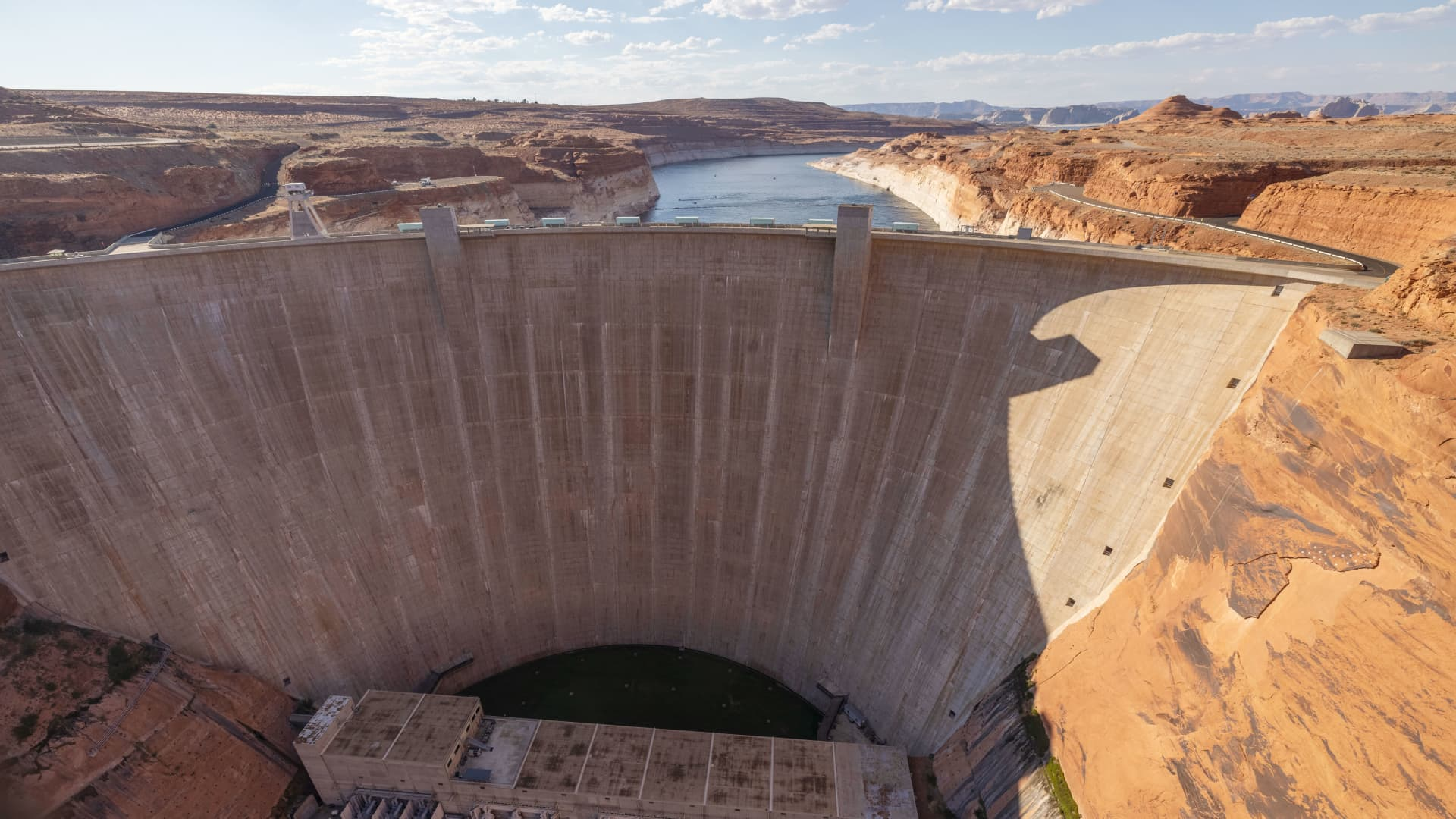 Glen Canyon Dam is seen, behind which are record low water levels at Lake Powell, as the drought continues to worsen on July 2, 2021 near Page, Arizona.