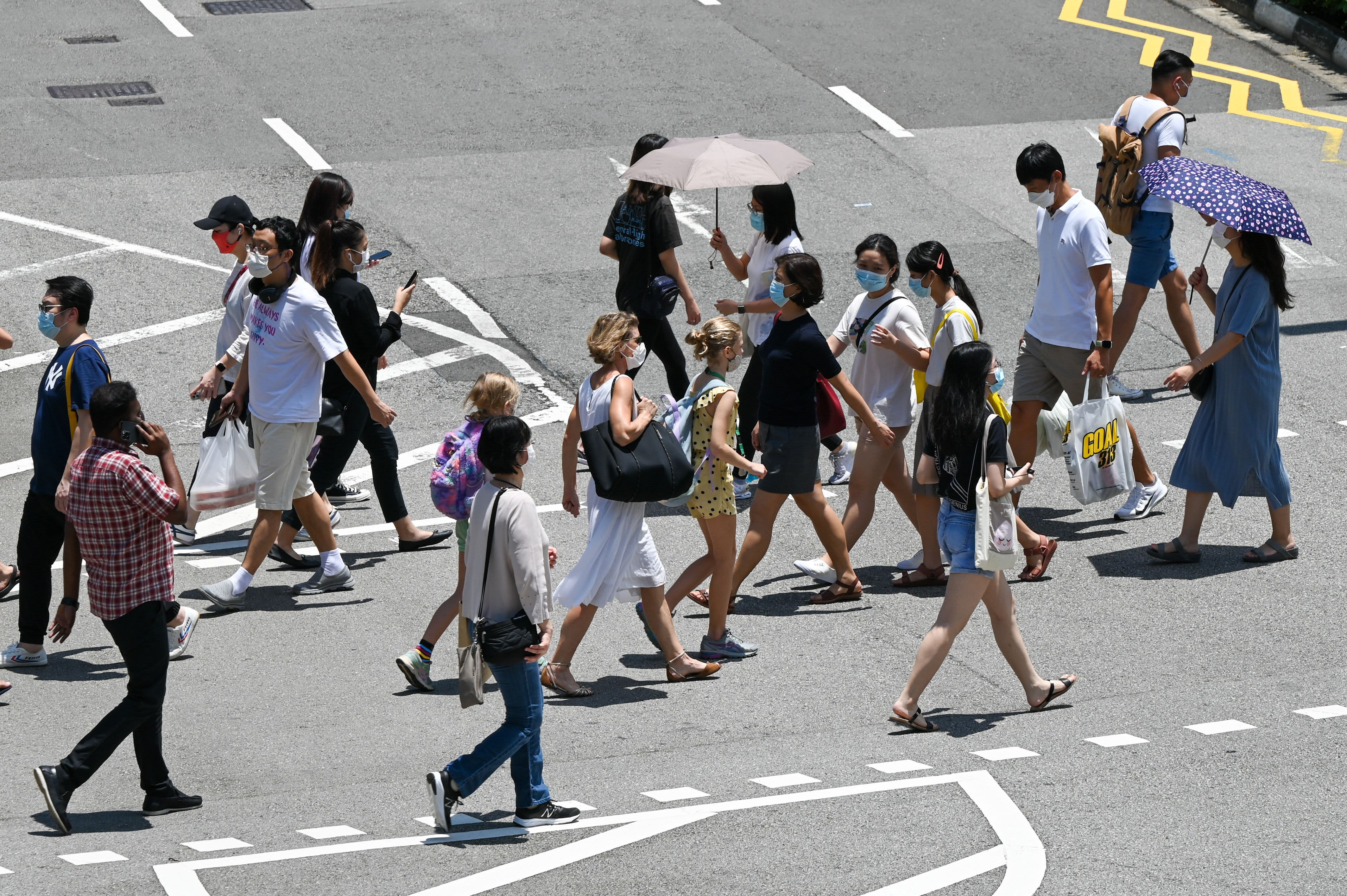 Singapore to open 'vaccinated travel lanes' with 8 more countries as it aims for 'new normal'