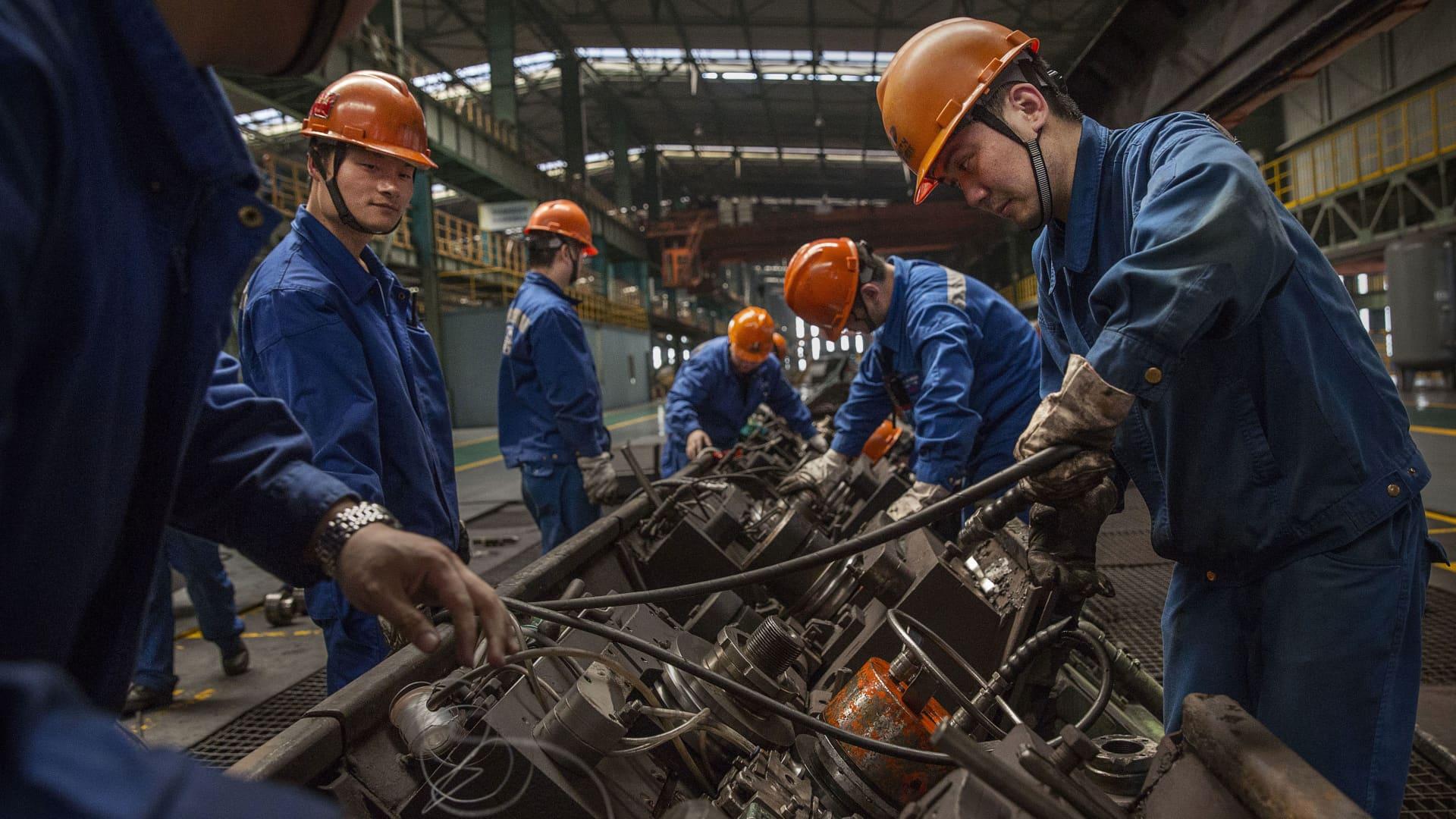 Workers at the Zhong Tian (Zenith) Steel Group Corporation in Changzhou, China's Jiangsu province on May 12, 2016.