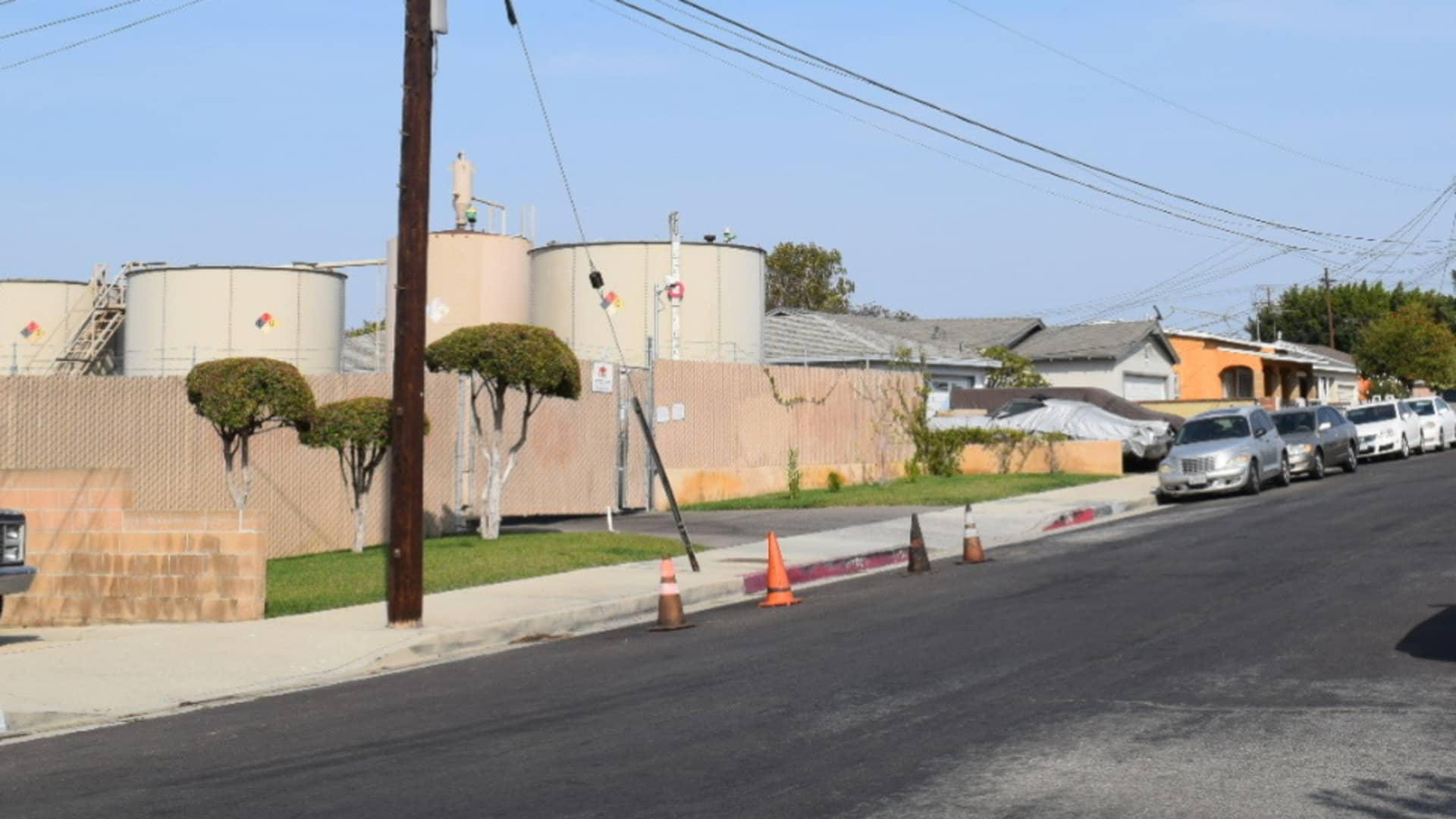 Oil tanks wedged between homes in the Wilmington neighborhood of Los Angeles.