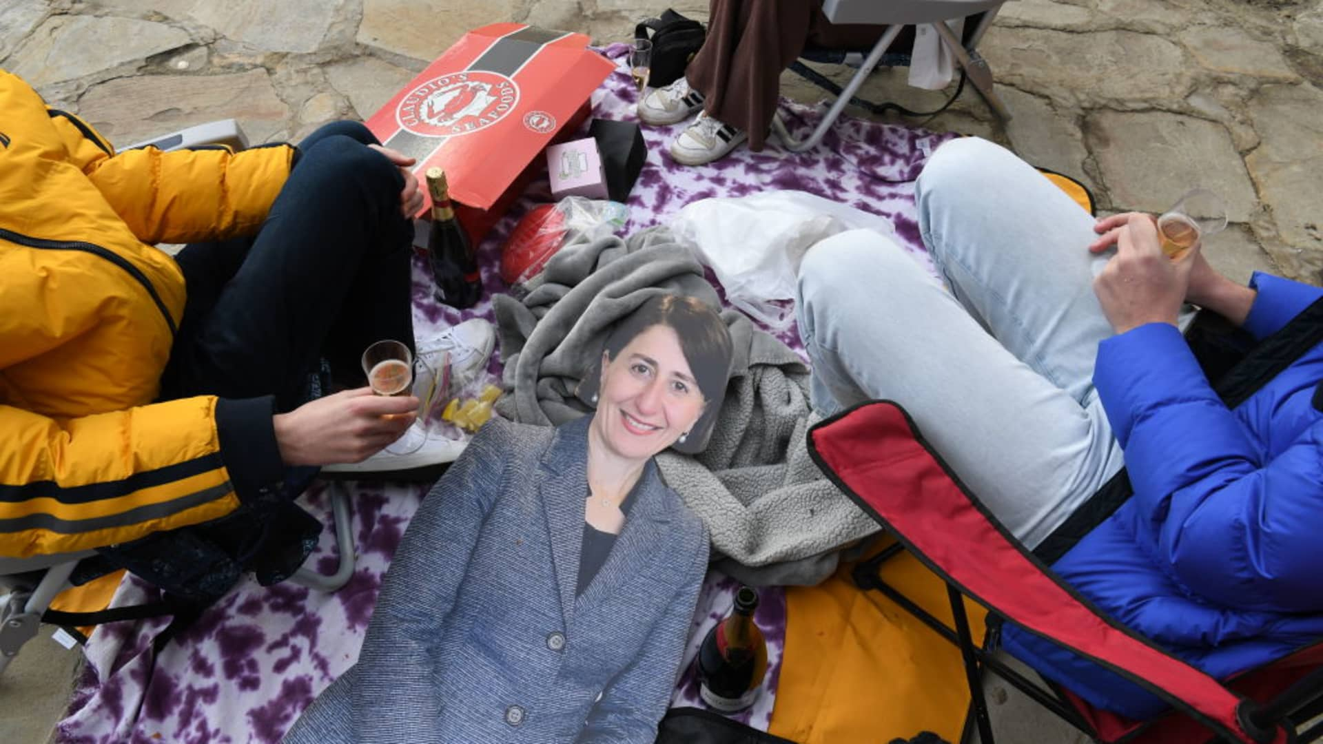 A life sized cardboard cutout of the Premier of New South Wales, Gladys Berejiklian sits on the floor beside some friends having a celebratory picnic in the suburb of Kirribilli on September 13, 2021 in Sydney, Australia.