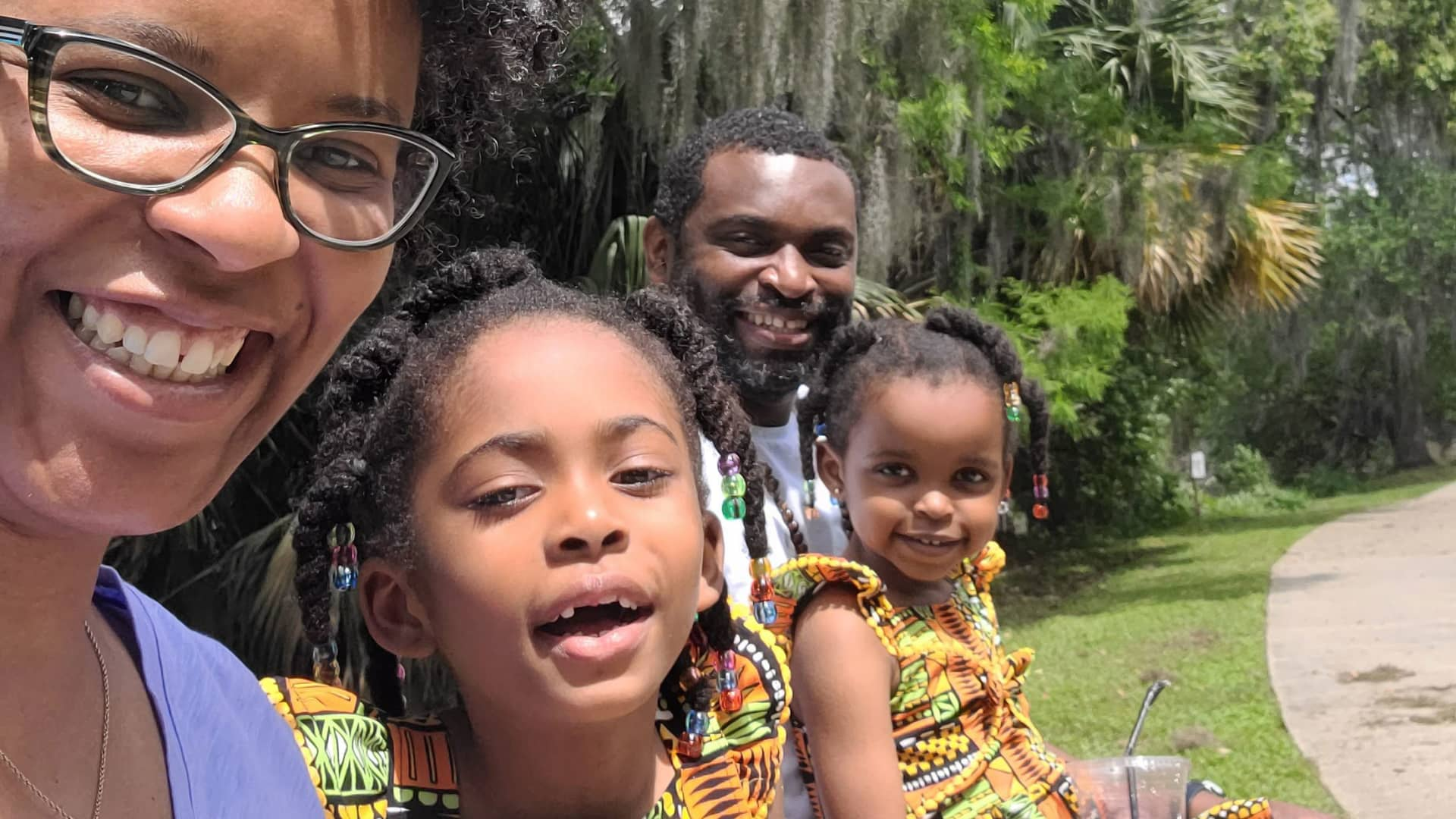 Adrienne Streater, pictured with her husband Douglas and two daughters, says having access to paid family leave would have helped tremendously when she was a new mother.