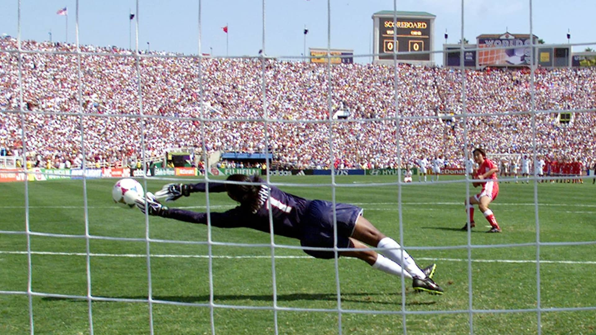 US goalkeeper Briana Scurry lunges as she stops the penalty kick by Liu Ying of the Chinese soccer team in a shoot-out at the end of their game in the finals of the Women's World Cup at the Rose Bowl in Pasadena, California 10 July 1999. The US team scored all of their five penalty shots to win the game.